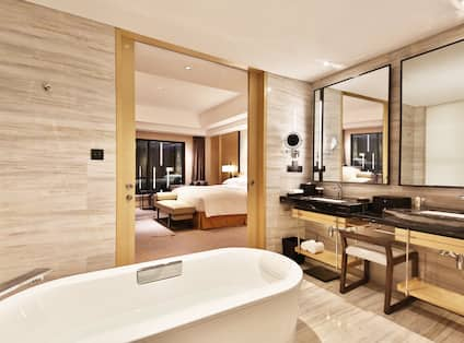 Guest Bathroom Tub, Two Mirrors, Two Sink and One King Bedroom