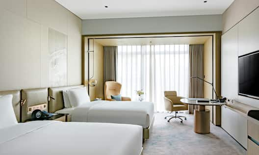 Executive Room with Desk HDTV and Two Beds
