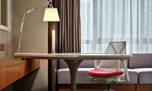 Close Up of Desk with Ergonomic Chair in Guest Room