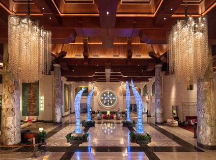 Lobby with large orient sculptures and chandeliers