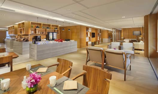 Executive Lounge Dining Seating Area with Chairs, Tables and Pay Counter
