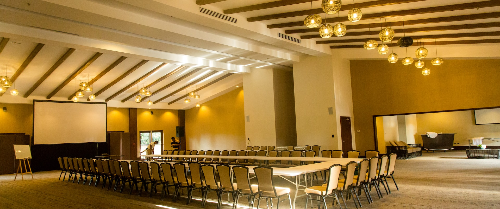 Ballroom with Large U-Shaped Conference Table and Projector Screen