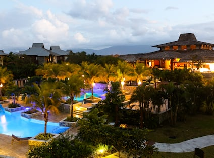 Evening View of Illuminated Pool and Hotel Property