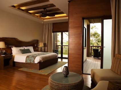 Room with Bed, Seating Area, and Balcony