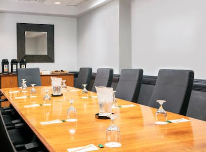 Boardroom with Large Meeting Table, Office Chairs and Coffee Station