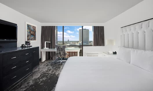 One King Bed Guest Bedroom with Work Desk, HDTV and Outside View