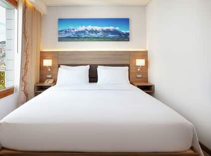 King Family Deluxe Room with Balcony View Bed