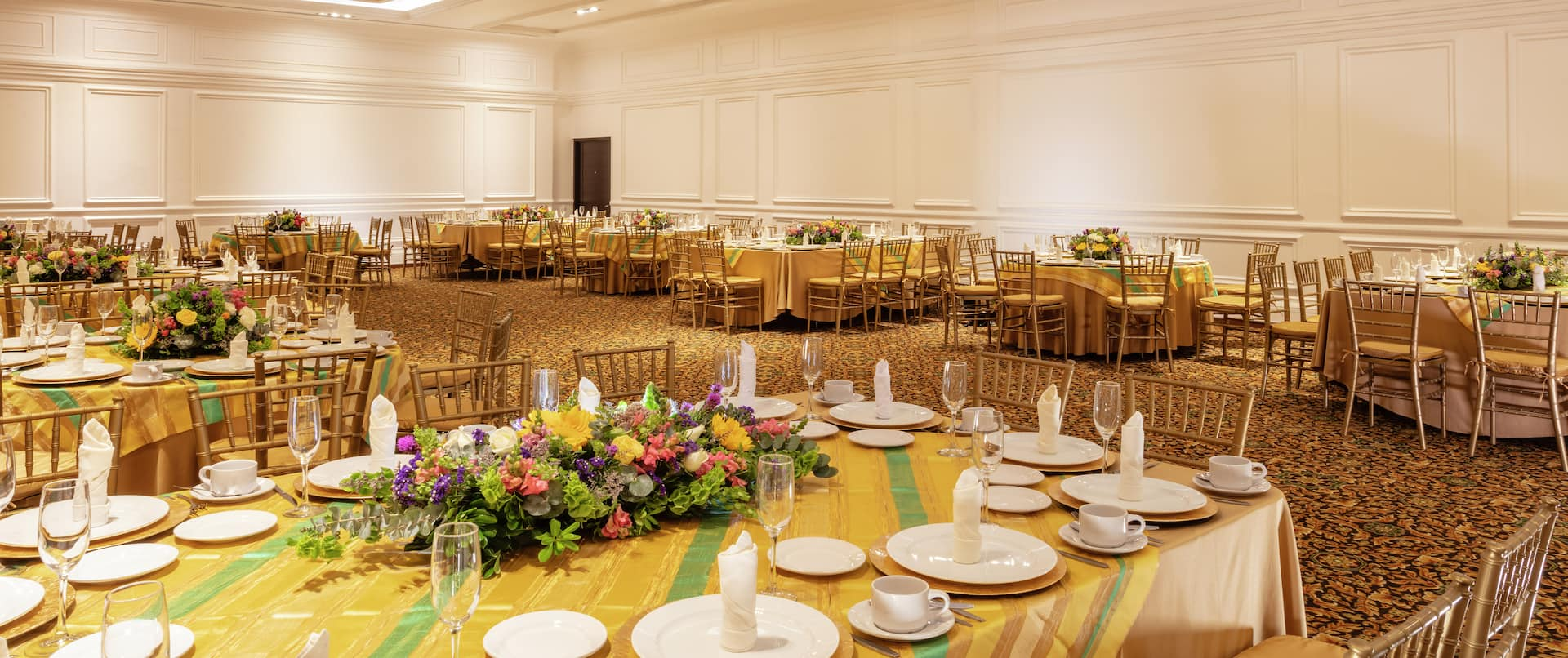 Elegant Banquet and Event Space with Dining Tables and Place Settings