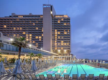 Pool and Hotel Exterior at Night