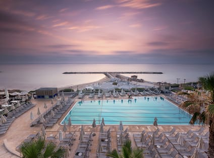 Outdoor Pool with Swim Lanes, Lounge Chair Seating, and Sea View