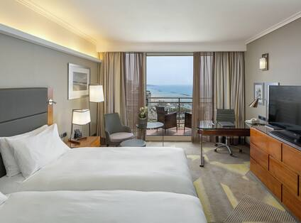 Guest Room with Two Twin Beds and Balcony