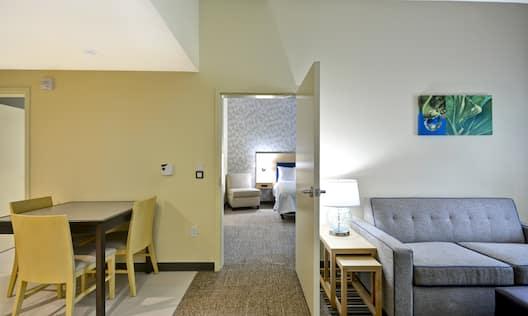 Guestroom Lounge Area with Bedroom Door Open