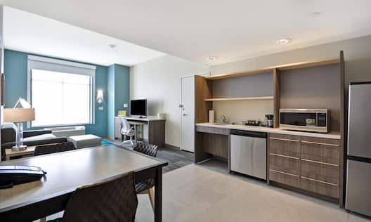 King Suite Kitchen with Fridge, Dishwasher, Microwave and Seating For Three at Dining Table