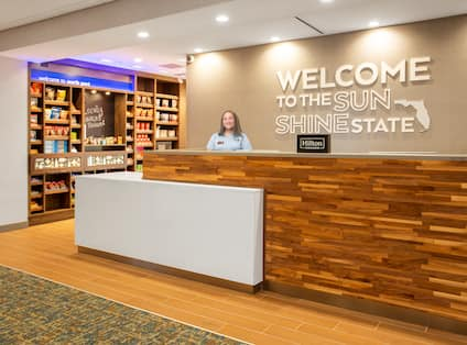 Reception Desk with Team Member and View of Snack Shop