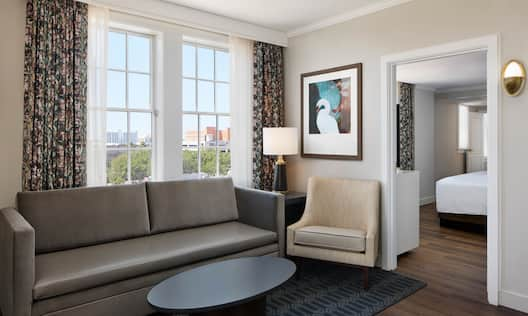 Suite Living Area with Large Windows and View of Separate Bedroom