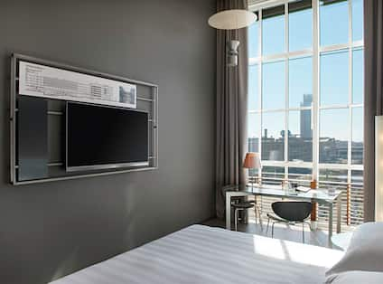 Suite with Work Desk and Wall-Mounted Television