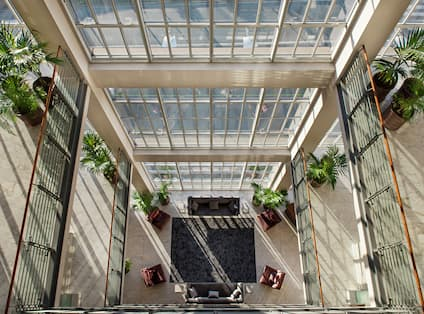 Overhead View of Lobby Seating in Atrium with Terrance and Floor to Ceiling Windows