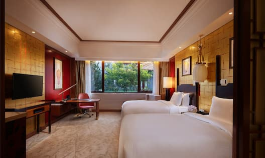 Twin-Sized Beds and Desk in Deluxe Room