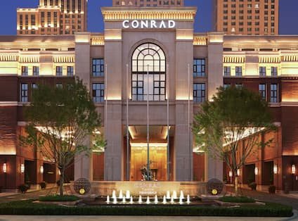 Night view of Conrad Tianjin Hotel with Trees in Front