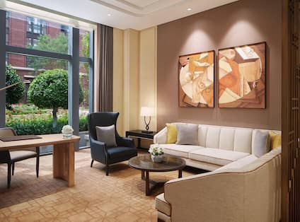 Living area in suite with comfortable seating