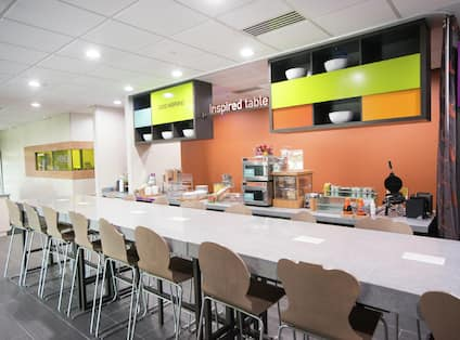 Community Dining Table, and Food Service Area Under Inspired Table Signage