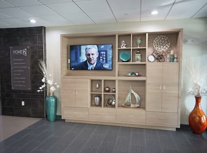 Lobby With Signage and TV in Decorated Media Cabinet