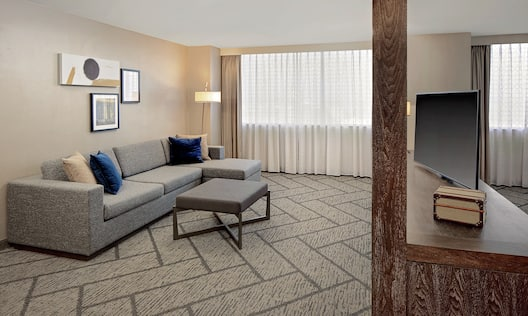 a suite seating area and tv