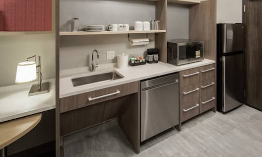 Guestroom Kitchen Area with Counter, Dishwasher, Microwave and Refridgerator