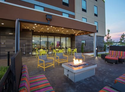 Outdoor Patio Area with Armchairs, Soft Seats and Firepit