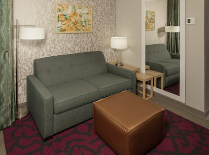 Guestroom Lounge Area with Sofa and Footrest