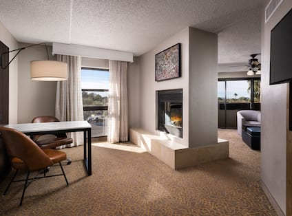 Overview of Suite with Fireplace and Work Desk Area