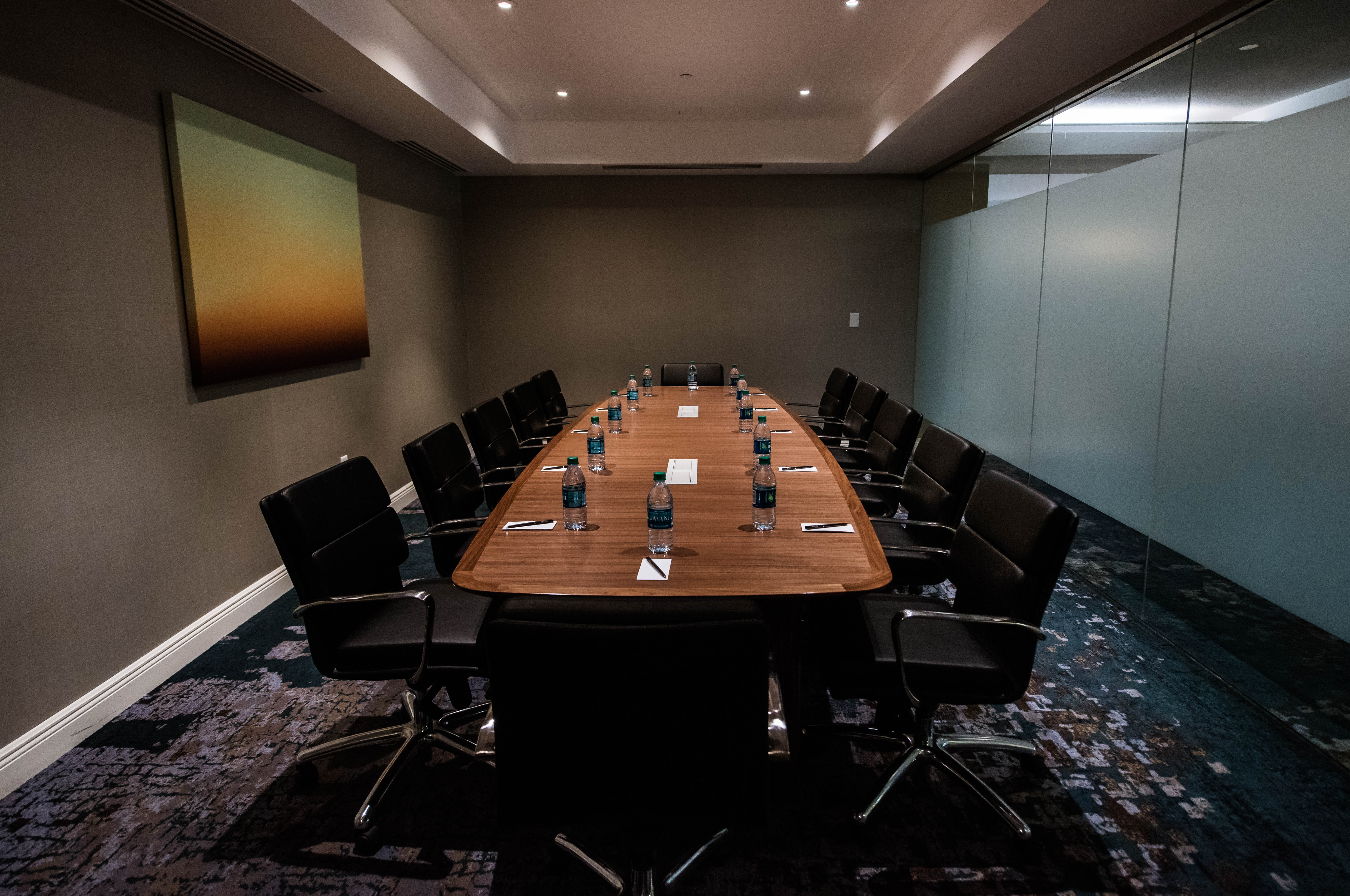 Boardroom table with black leather chairs