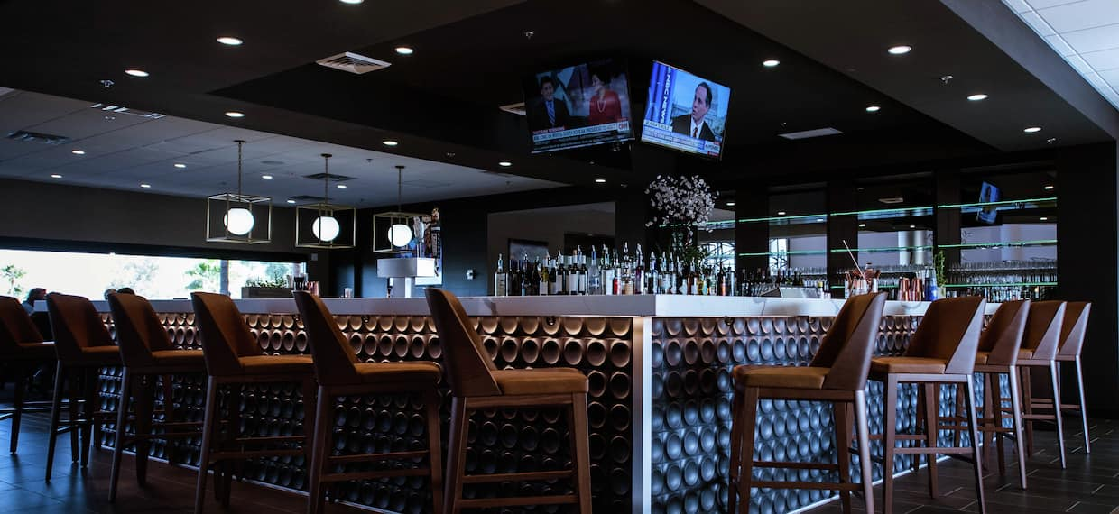 TVs and Counter Seating at Fully Stocked D.O.C Bar and Lounge