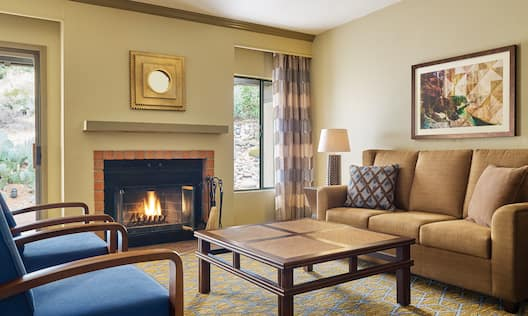Casita Living Room with Fireplace Sofa Chairs, Table and Outside View