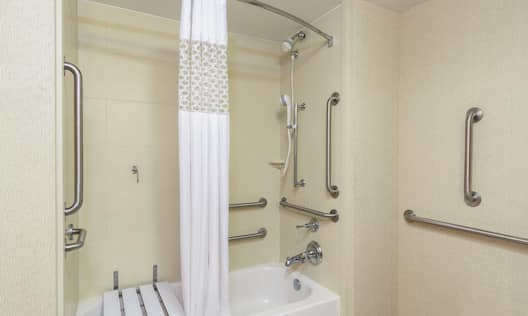 Accessible Bathroom with Tub Seat and Grab Bars