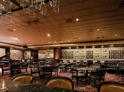 Bar Lounge Area with Armchairs and Tables
