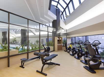 Fitness Center with Weight Bench, Rowing Machine and Cycle Machines