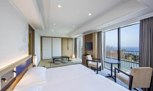 Guestroom with Two Beds, Outside View, Lounge Area, and Room Technology