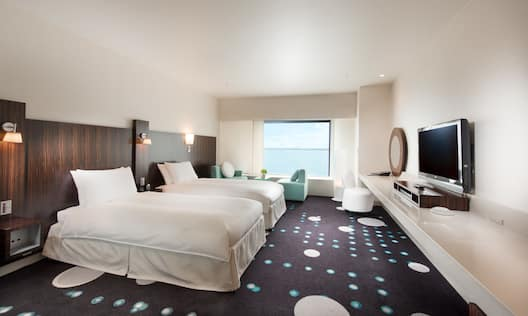 Celebrio Select Guest Room With Two Twin Beds, Seating by Window With Ocean View, and TV