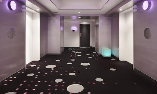 celebrio Elevator Landing Illuminated in Purple Light