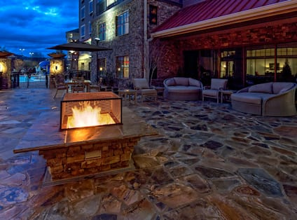 Outdoor Patio With Fire Pit At Night