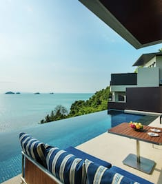 Pool terrace with view of table and chairs