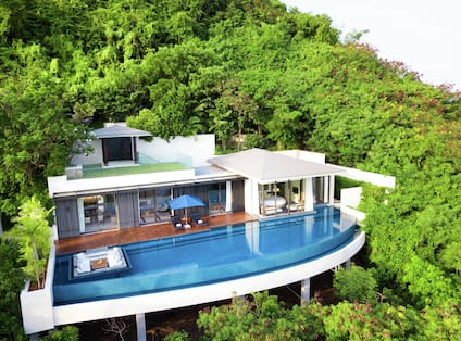Exterior of villa surrounded by trees