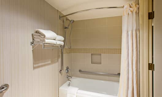 Accessible Bathroom with Towel Shelf and Tub