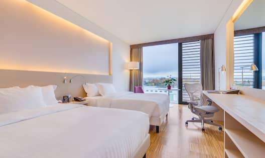 2 Queen Sized Beds Evolution Room 1