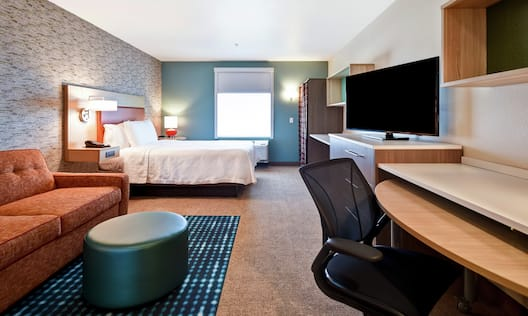 King Bed, Lounge Area and Work Desk in Suite