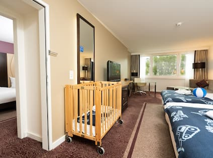 View of Bed and Crib in Suite