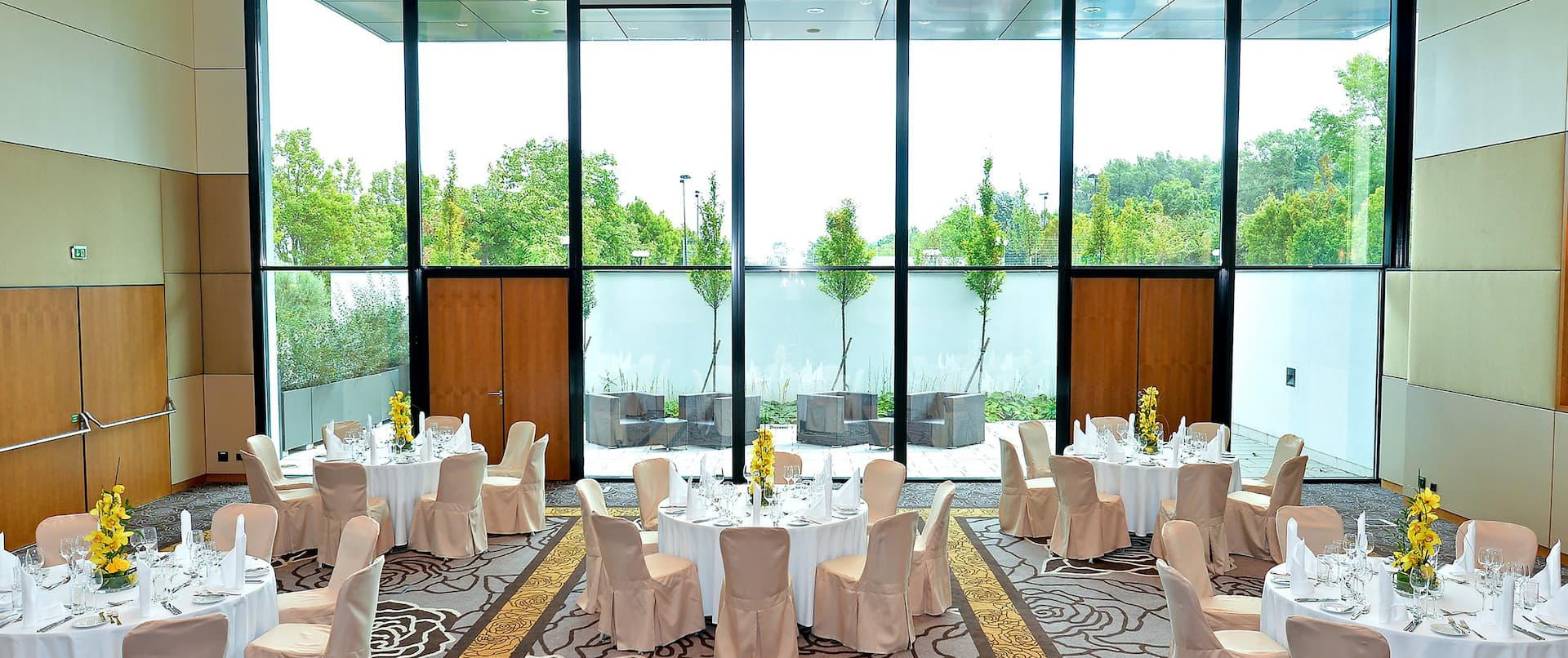 Meeting Room with Banquet Tables and Floor to Ceiling Windows