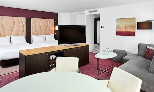 Family Suite with Two Queen Beds, Working Desk at End of Beds with TV as well as a Lounge Area