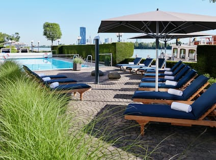 Outdoor Pool with Lounging Chairs and Large Sun Umbrellas